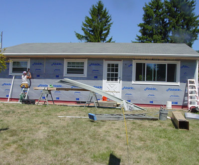 Workers Replacing Siding
